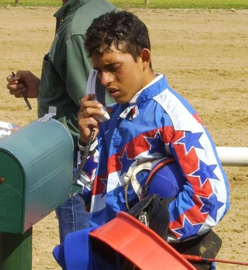 Jockey Oscar Delgado gets in touch with the stewards after a race at Mount Pleasant Meadows.